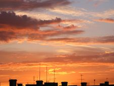 Orange Clouds Over A House Top Royalty Free Stock Photography