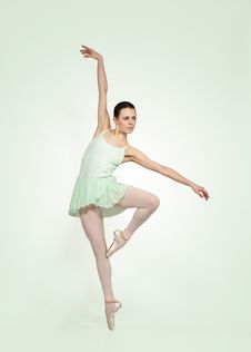 Young Beautiful Ballerina On A Green Background Royalty Free Stock Photos