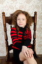 Free Portrait Of Little Girl Sitting On A Chair Royalty Free Stock Image - 24786826