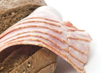Raw Bacon With Bread Royalty Free Stock Images