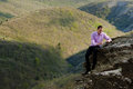 Free Man With Notepad On Stone Stock Photo - 24793400