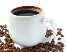 Free Coffee Cup And Coffee Beans Royalty Free Stock Image - 24790096