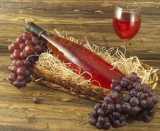Bottle Of Pink Wine In A Basket. Royalty Free Stock Photo