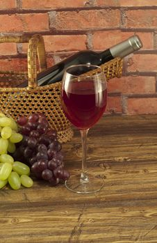 Free Bottle Of  Wine In A Basket. Royalty Free Stock Image - 24797276