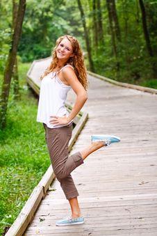 Fun-loving Teenage Girl Walking In A Park Stock Photo