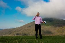 Free Man With Notepad And Telephone On Mountain Stock Images - 24800104