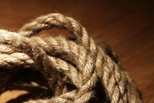 Free Old Rope Over Wooden Surface Royalty Free Stock Photos - 24802598
