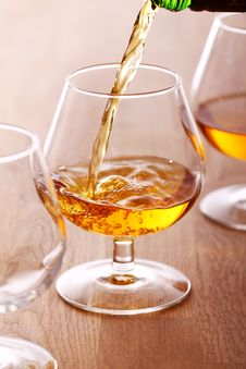 Pouring Cognac Into The Glass Stock Image