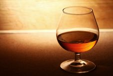Free Glass Of Cognac Over Wooden Surface Royalty Free Stock Images - 24802889