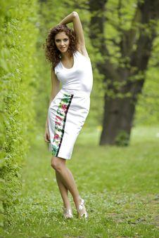 Free Brunette In The Garden Stock Image - 24803461