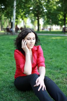 Free Girl With The Phone Sitting On The Grass Stock Photos - 24804463