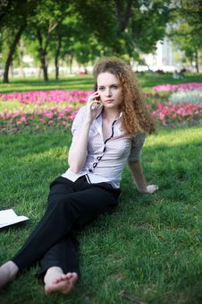 Free Redhead Curly Girl With The Phone Talking Royalty Free Stock Photo - 24804535