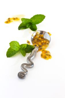 Free Granadilla Pulp On A Silver Spoon Stock Photo - 24806000