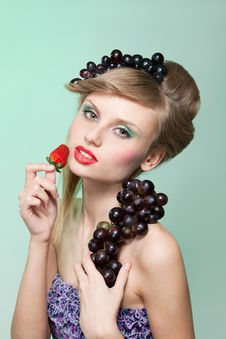 Woman With Strawberry And Bunch Of Grapes Stock Photography