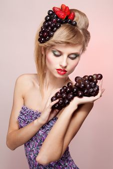 Woman With Strawberry And Bunch Of Grapes Stock Photo