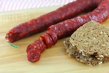 Free Cured Paprika Sausage With Wholewheat Bread Stock Photo - 24831890