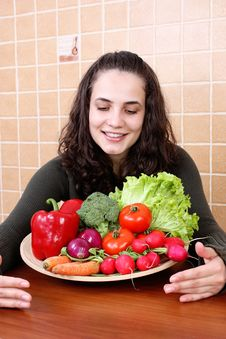 Free Young Woman Eating Vegetable Salad Stock Images - 24834384