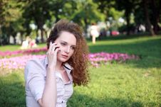 Free Cute Curly Girl Talking On The Phone Stock Photography - 24836912
