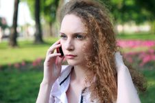 Free Portrait Of A Pretty Girl With Curly Phone Royalty Free Stock Photo - 24836935