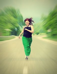Free Happy Girl Running Down The Road Royalty Free Stock Images - 24842099
