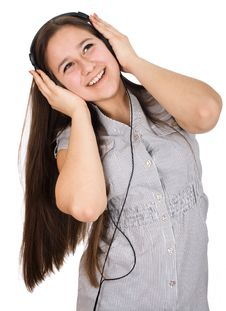 Free Girl Listening To Music On Headphones Royalty Free Stock Images - 24852579
