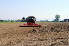 Free Red Tractor Prepares Soil Stock Photography - 24854142