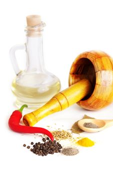 Mortar With Pestle, Variety Of Spices And Oil Royalty Free Stock Image