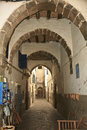 Free Arched Walkway In Essaouira Royalty Free Stock Photography - 24869187