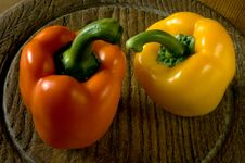 Free Two Sweet Peppers On A Wooden Board. Royalty Free Stock Photos - 24863398