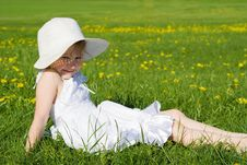 Free Happy Little Girl Lying On Grass Stock Photos - 24872923