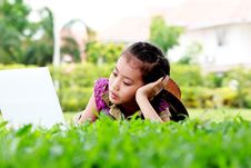 Free Cute Of Little Girl Play Laptop Royalty Free Stock Image - 24877336