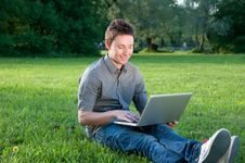 Free Man With Laptop Royalty Free Stock Photo - 24898385