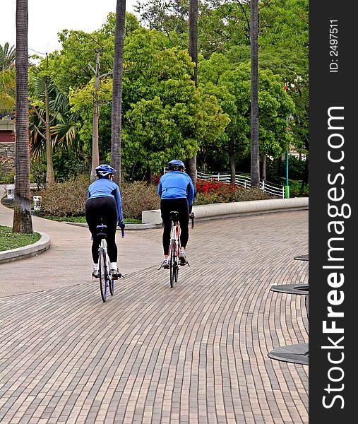 Blue Cyclists on Path
