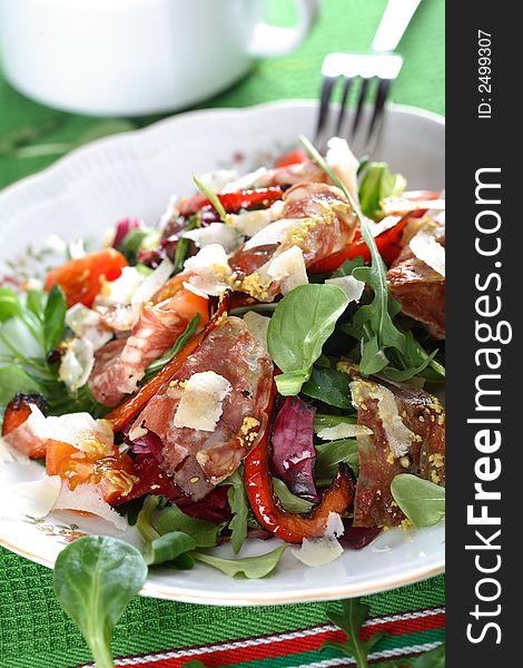 Mixed salad with salami