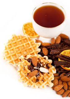 Free Sweet Waffles With Chocolate, Nuts And A Cup Of Te Royalty Free Stock Image - 24915366