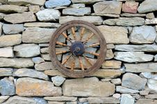 Free Vintage Spinning Wheel On Stone Wall Royalty Free Stock Photo - 24918795