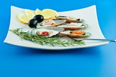 Oysters With Lemon And Olives Stock Photo