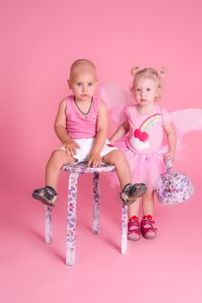 Boy And Girl On A Pink Background Royalty Free Stock Image