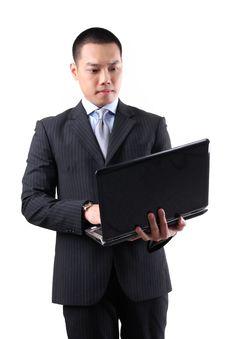 Free Young Asian Businessman Holding Laptop Stock Photos - 24922073