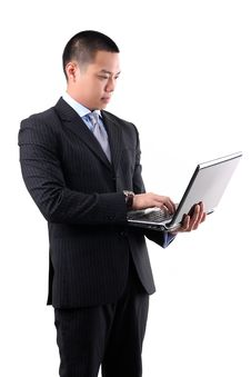 Free Young Asian Businessman Holding Laptop Royalty Free Stock Photos - 24922098