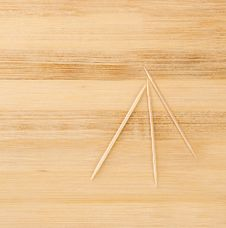 Free Three Toothpicks On A Wooden Table Royalty Free Stock Photo - 24926815