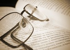 Free Eyeglasses On The Old Thick Book. Royalty Free Stock Photos - 24927908