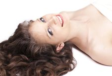 Free Happy Woman With Curly Hair Lying On The Floor Stock Photography - 24933412