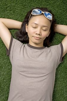 Sleeping Woman On Grass Stock Photography