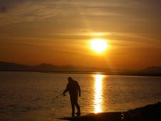 Free Fisherman On The Sunset Royalty Free Stock Image - 24939146