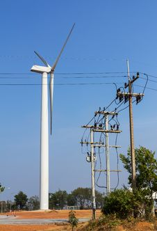 Wind Turbine And Power Lines Transporting Royalty Free Stock Photo