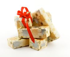 Stack Of Gift Boxes And One With Red Bow Royalty Free Stock Photos