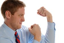 Young Businessman Showing Fists And Ready To Fight Royalty Free Stock Images