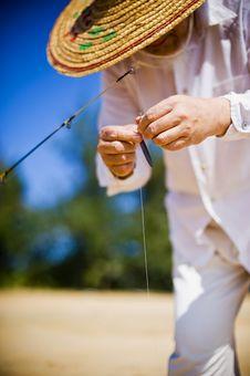 Free Fisherman Preparing The Rod Royalty Free Stock Image - 24962516