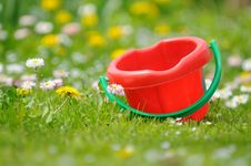 Free Kids' Sand Bucket In The Garden Stock Images - 24964284